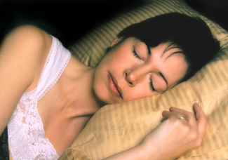 woman sleeping after insomnia cure